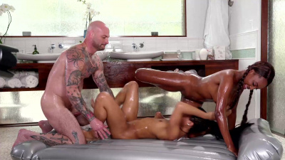Ebony masseuses Kira Noir and Daya Knight have sex with client and give blowjob