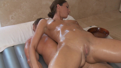 Tall masseuse Angelica Saige stroking lucky dude's boner