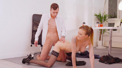 Executive assistant Belle Claire feeds on her boss's cock