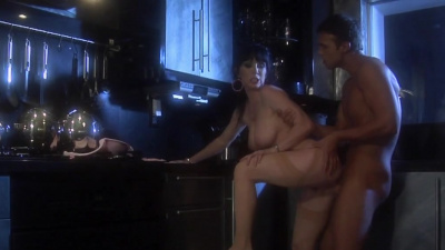 Glamorous cougar Rayveness makes a guy blow his load on her hairy cunt